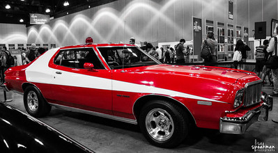 Day 124 ~ Starsky and Hutch Went to the Big Photo Show at the LA Convention Center. Wasn't all that impressed by the show quite frankly... but it was kinda cool to see a few old TV and Movie cars on display. I guess they were gonna teach how to shoot cars... but I never really saw any of that going on. And just like with every car show I've been to... cars too close together, too many people and ugly backgrounds. Throw in the ugly ass light in that place and you end up with a photo screaming for selective color.
